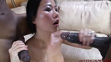 Asian Fucking And Sucking A Monster Black Cock