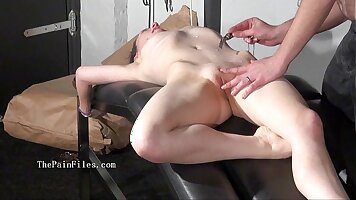 Pretty babe fucked with a strapon in BDSM dungeon