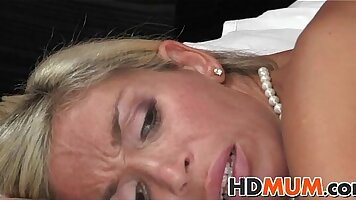 Blonde in red bray eating a huge white pecker