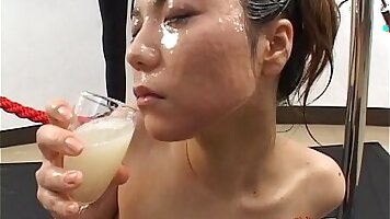 Beautiful Japanese chick in jacket swallows loads